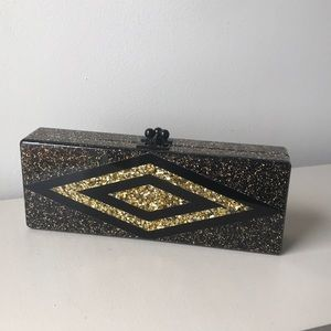 Edie Parker black and gold clutch